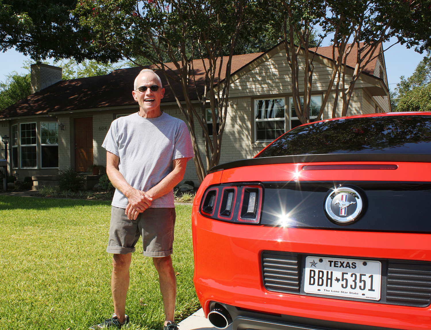 Terry Box, a 32-year resident of the Heights,. stands beside his 2013 Mustang Boss 302.